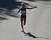 Shalane Flanagan, 2017 NYC Marathon women's winner, waves to the crowd as she nears the finish line in Central Park during the New York City Marathon on Sunday, Nov. 4, 2018. She finished in third place.