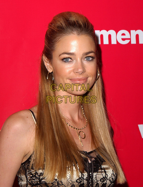 DENISE RICHARDS.Attend Lifetime Television's 5th Annual Women Rock! Concert for the fight against breast cancer held at The Wiltern Theatre in Los Angeles, California, USA, September 28 2004..portrait headshot gold necklace hoop earrings womenrock cream gold satin camisole vest top black lace .Ref: DVS.www.capitalpictures.com.sales@capitalpictures.com.©Debbie VanStory/Capital Pictures .