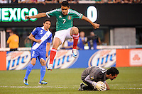 Pablo Barrera (7) of Mexico jumps over Guatemala goalkeeper Ricardo Jerez (1). Mexico defeated Guatemala 2-1 during a quarterfinal match of the 2011 CONCACAF Gold Cup at the New Meadowlands Stadium in East Rutherford, NJ, on June 18, 2011.