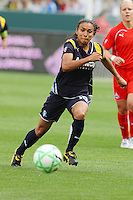 Marta #10 of the Los Angeles Sol chases down a loose ball against the Washington Freedom during their inaugural match at Home Depot Center on March 29, 2009 in Carson, California.