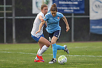 Piscataway, NJ, May 13, 2016. Sky Blue defender Kelley O'Hara (19) keeps the ball away from Boston Breakers midfielder Louise Schillgard (10). Sky Blue FC defeated the Boston Breakers, 1-0, in a National Women's Soccer League (NWSL) match at Yurcak Field.