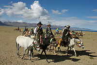 "Early morning Nomads on horseback at the edge of Namtso Lake..Namtso Lake :Namtso, another holy lake in Tibet, is located near Damxung. 4718 meters (15475 feet) above sea level and covering 1900 square kilometers (735 square miles), the lake is the highest saltwater lake in the world and the second largest saltwater lake in China. The snow capped Mt. Nyainqentanglha, considered as the son of Namtso and leader of sacred mountains, soars up to sky beside her. Singing streams converge into the clean sapphire blue lake, which looks like a huge mirror framed and dotted with flowers..The Namtso Lake is held as ""the heavenly lake"" or ""the holy lake"" in northern Tibet. .Respected as one of the three holiest lakes in Tibet, the Namtso Lake is the seat of Paramasukha Chakrasamvara for Buddhist pilgrims. In the fifth and sixth month of the Tibetan calendar each year, many Buddhists come to the lake pay homage and pray. Deep tracks are worn into the lakeshore due to this activity. In history, monasteries stood like trees in a forest around the site, attracting large numbers of pilgrims as eminent monks in Buddhist temples extended Buddhist teachings...Buddhists believe Buddhas, Bodhisattvas and Vajras will assemble to hold religious meeting at Namtso in the year of sheep on Tibetan calendar. It is said that walking around the lake at the right moment is 100,000 times more efficacious than that in normal years. That's why thousands of pilgrims from every corner of the world come to pray at the site, with the activity reaching a climax on Tibetan April 15...Walking around the lake takes a week. Ritual walkers love to burn aromatic plants to raise smoke on Auspicious Island [explain this a little] and throw a piece of hada scarf into the lake as a token of fulfilled wishes. If the scarf sinks, it implies ones wish is accepted by the Buddha; if the scarf flows on the water or only half sinks, it means one has failed to be honest and something unhappy may lie ahead...On the four sid"