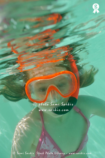 Girl with snorkeling gear underwater (Licence this image exclusively with Getty: http://www.gettyimages.com/detail/84430631 )