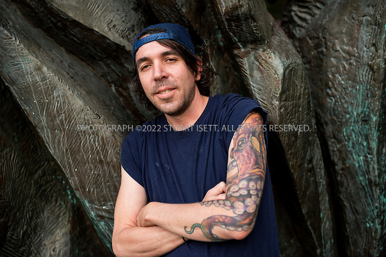 10/16/2014&mdash;Seattle, WA, USA<br /> <br /> Derek Ronspies, owner and chef at Le Petit Cochon in Seattle&rsquo;s Fremont neighborhood, posing near his restaurant, showing his octopus tattoo.<br /> <br /> Photograph by Stuart Isett<br /> &copy;2014 Stuart Isett. All rights reserved.