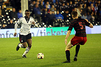 Moussa Dembele of Fulham takes on Reading's Robert Dickie