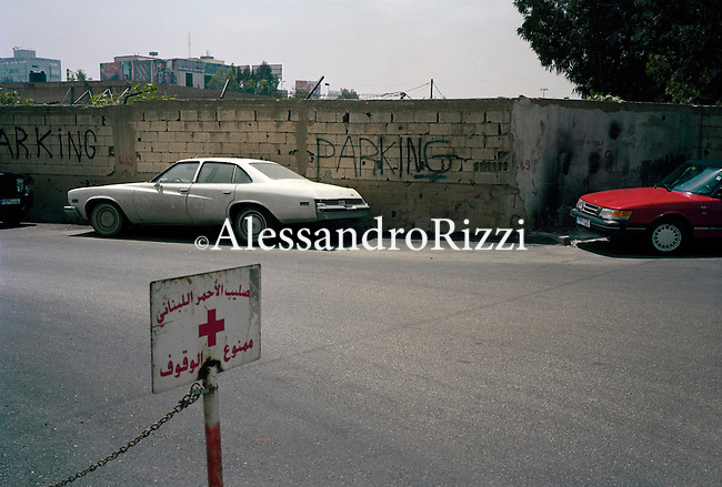 A parked car near a wall