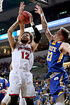 SIOUX FALLS, SD: MARCH 6: 	Trey Burch-Manning #12 from the University of South Dakota takes the ball to the basket against Reed Tellinghuisen #23 from South Dakota State University during the Summit League Basketball Championship on March 6, 2017 at the Denny Sanford Premier Center in Sioux Falls, SD. (Photo by Dave Eggen/Inertia)