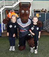 Broncos mascot poses with two young fans during the Kingstone Press Championship game between London Broncos and Bradford Bulls at Ealing Trailfinders, Ealing, on Sun March 5, 2017