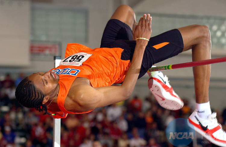 "12 MAR 2005: Mickael Hannay  (567) of the University of Texas-El Paso competes in the men's high jump competition. Hannay finished the event in 5h place with a leap of 7' 2 1/2"" during the 2005 Division I Indoor Track and Field Championship held in the Randal Tyson Track Center on the University of Arkansas campus in Fayetteville, AR. Jesse Williams of USC went on to win the event with a jump of 7' 5"" for the title. Tom Ewart/NCAA Photos."