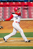 Aaron Nardone #30 of the Delaware State Hornets follows through on his swing against the Georgetown Hoyas at Gene Hooks Field on February 26, 2011 in Winston-Salem, North Carolina.  Photo by Brian Westerholt / Four Seam Images