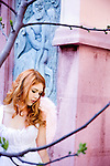girl with angel wings in front of wall with sculpted mural of centaurus kindnapping maiden