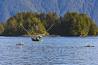 Kayakers and commercial fishing trolling vessel in Sitka Sound, Baranof Island, southeast, Alaska.
