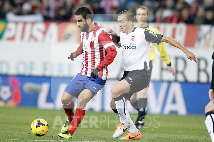 Atletico de Madrid's Arda Turan (l) and Valencia's Oriol Romeu during La Liga match.December 15,2013. (ALTERPHOTOS/Acero)
