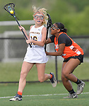 O'Fallon's Mikaela Triujillo (left) carries the ball as she's pressured by Minooka's Katelyn Deshazer. O'Fallon played Minooka in a quarterfinal game of the O'Fallon sectional at O'Fallon Sports Park on Monday May 20, 2019. <br /> Tim Vizer/Special to STLhighschoolsports.com