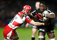 Photo: Richard Lane/Richard Lane Photography. Gloucester Rugby v Stade Toulouse. Heineken Cup. 20/01/2012. Toulouse's Yannick Nyanga is tackled by Gloucester's Alasdair Strokosch.