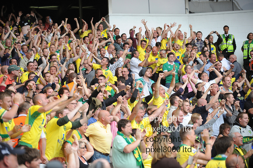 Norwich City fans celebrate during the Barclays Premier League match between Tottenham Hotspur and Norwich City at White Hart Lane on September 1, 2012 in London, England. Picture Zed Jameson/pixel 8000 ltd.