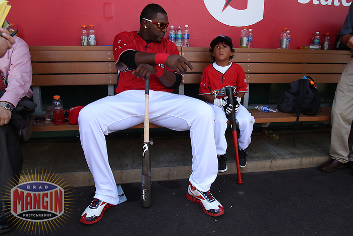 ANAHEIM - JULY 12:  David Ortiz of the American League sits in the dugout with his son D'Angelo Ortiz before the Home Run Derby during All Star Game festivities at Angel Stadium on June 12, 2010 in Anaheim, California. Photo by Brad Mangin