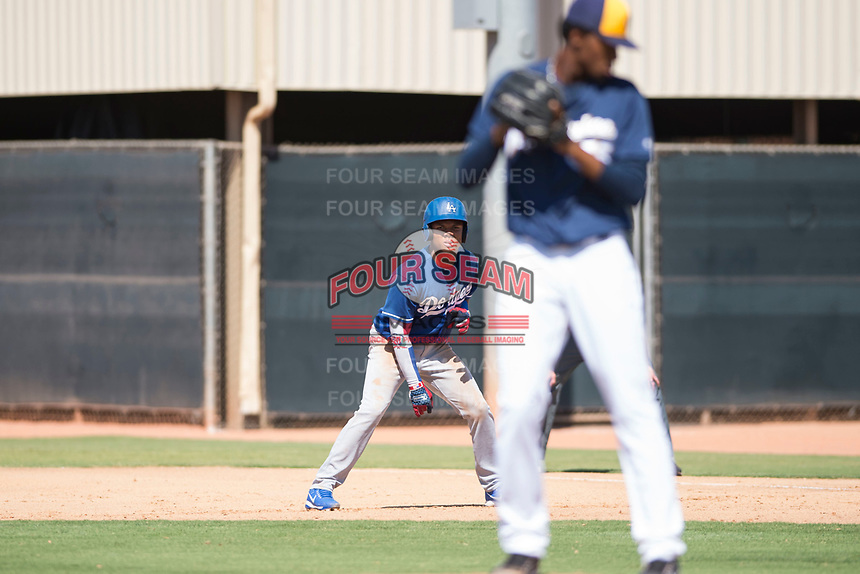 Los Angeles Dodgers outfielder Yunior Garcia (78) takes a lead off first base during an Instructional League game against the Milwaukee Brewers at Maryvale Baseball Park on September 24, 2018 in Phoenix, Arizona. (Zachary Lucy/Four Seam Images)