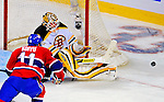 22 November 2008: Boston Bruins' goaltender goaltender Tim Thomas in action during the second period against the Montreal Canadiens at the Bell Centre in Montreal, Quebec, Canada.  After a 2-2 regulation tie and a non-scoring overtime period, the Boston Bruins scored the lone goal in a shootout thus defeating the Canadiens 3-2. The Canadiens, celebrating their 100th season, honored former Montreal goaltender Patrick Roy, and retired his jersey (Number 33) during pre-game ceremonies. ***** Editorial Use Only *****..Mandatory Photo Credit: Ed Wolfstein Photo *** Editorial Sales through Icon Sports Media *** www.iconsportsmedia.com