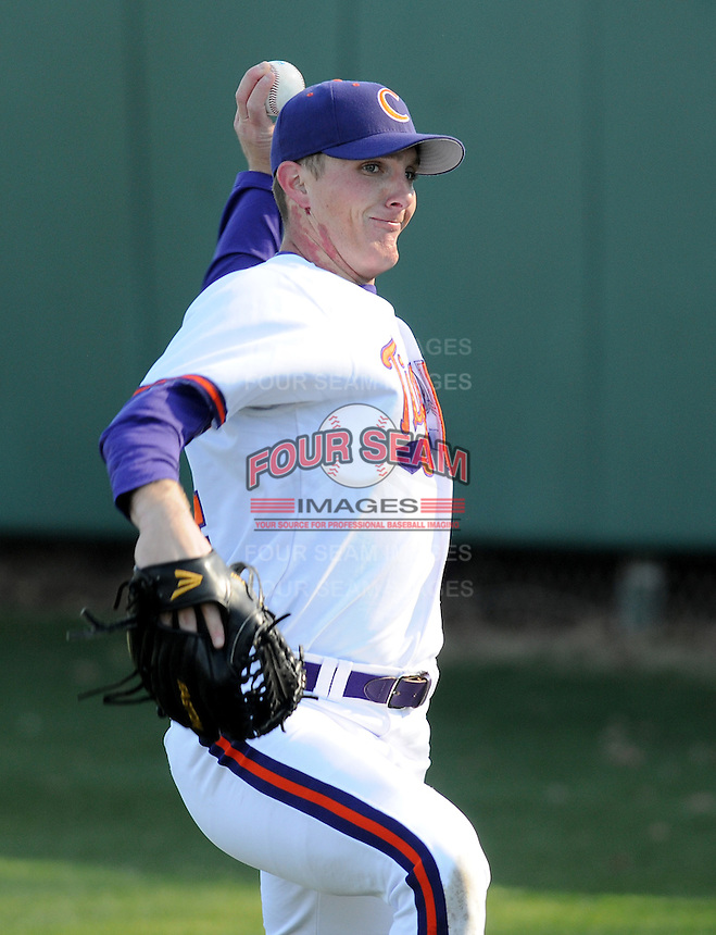 Starting pitcher Matthew Crownover (44) of the Clemson Tigers warms up prior to a game against the Wofford Terriers on Wednesday, March 6, 2013, at Doug Kingsmore Stadium in Clemson, South Carolina. Clemson won, 9-2. (Tom Priddy/Four Seam Images)