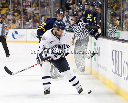 Damon Kipp (UNH - 4), Brendan Ellis (Merrimack - 22) - The Merrimack College Warriors defeated the University of New Hampshire Wildcats 4-1 (EN) in their Hockey East Semi-Final on Friday, March 18, 2011, at TD Garden in Boston, Massachusetts.