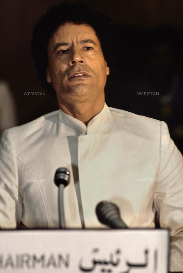 LIBYA, TRIPOLI - 1982. Portrait of the Libyan leader Muammar Abu Minyar al-Gaddafi during the Organisation of African Unity (OAU)meeting.<br /> <br /> LIBYE, TRIPOLI, 1982: Portrait du leader Libyen Mouammar Abu Minyar Kadhafi pendant  la conference de l'Organisation de l'Unite Africaine (OAU)
