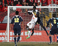 Sunny Jane #10 of the University of Maryland is beaten to a header by Kofi Opare #6 of the University of Michigan during an NCAA quarter-final match at Ludwig Field, University of Maryland, College Park, Maryland on December 4 2010.Michigan won 3-2 AET.