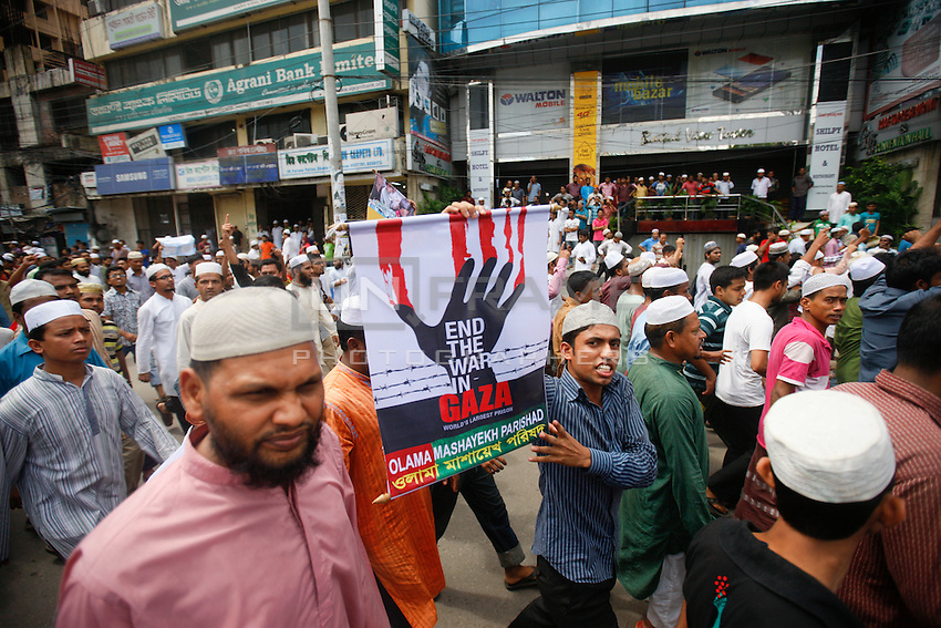 """Thousand of activists from several Islamic organizations march in a procession in front of the Baitul Mukarram National Mosque to protest against the ongoing Israeli operation """"Protective Edge"""" and the heavy attacks to the  Gaza Strip which already caused hundreds of casualties , mostly between  civilians and children. Protective Edge is rapidly becoming one of the most dramatic and repressive operations of the Israeli-Palestinian conflict to date. Dhaka, Bangladesh"""