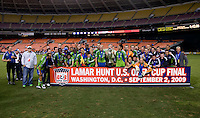 The Seattle Sounders pose with their trophy after the Lamar Hunt U.S. Open Cup at RFK Stadium in Washington, DC.  The Seattle Sounders defeated DC United, 2-1.