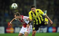 FUSSBALL   CHAMPIONS LEAGUE   SAISON 2012/2013   GRUPPENPHASE   Borussia Dortmund - Ajax Amsterdam                            18.09.2012 Christian Eriksen (li, Ajax) gegen Sebastian Kehl (re, Borussia Dortmund)