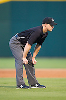 Third base umpire Ian Fazio during the International League game between the Louisville Bats and the Charlotte Knights at BB&T Ballpark on June 26, 2014 in Charlotte, North Carolina.  The Bats defeated the Knights 6-4.  (Brian Westerholt/Four Seam Images)