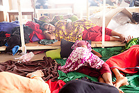 Bangladeshi garments Workers lay weary on Tuba Group's garments factory, on the fifth day of their hunger strike demandin outstanding three months salary and Eid bonuses. Dhaka, Bangladesh