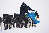 Jessica Hendricks Runs Up Riverbank into Kaltag Chkpt 2005 Iditarod