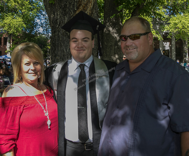 Graduate Greg Holm with dad Mike and stepmom Kim during the University of Nevada College of Engineering, College of Science and Orvis School of Nursing graduation ceremony on Thursday evening, May 18, 2017.