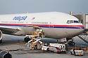 Ground Crew Staff Loading Malaysia Airlines Airplane