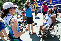 Minda (rt) and Julie Cook share a laugh after the Awards Ceremony for the Aquaphor New York City Triathlon in New York on July 8, 2012.