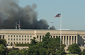 Washington, D.C. - September 11, 2001 -- Helicopters patrol over the Pentagon in Washington, D.C. during the fire caused by the terrorist attack on Tuesday, September 11, 2001..Credit: Ron Sachs / CNP.