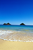 A mid-morning photo of the Mokulua islands off the coast of Kailua beach of Oahu.