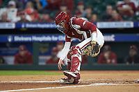 Arkansas Razorbacks catcher Casey Opitz (12) reaches for the baseball during the game against the Baylor Bears in game nine of the 2020 Shriners Hospitals for Children College Classic at Minute Maid Park on March 1, 2020 in Houston, Texas. The Bears defeated the Razorbacks 3-2. (Brian Westerholt/Four Seam Images)