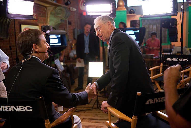 UNITED STATES - AUGUST 12:  Sen. Charles Grassley, R-Iowa, greets Chuck Todd, host of The Daily Rundown on MSNBC, at Java Joe's Coffeehouse where the show was being filmed on location in Des Moines, Iowa.  (Photo By Tom Williams/Roll Call)