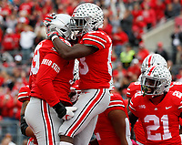 Ohio State Buckeyes wide receiver Terry McLaurin (83) celebrates with Ohio State Buckeyes offensive lineman Isaiah Prince (59) after scoring a touchdown during the first quarter of a NCAA college football game between the Ohio State Buckeyes and the Minnesota Golden Gophers on Saturday, October 13, 2018 at Ohio Stadium in Columbus, Ohio. [Joshua A. Bickel/Dispatch]