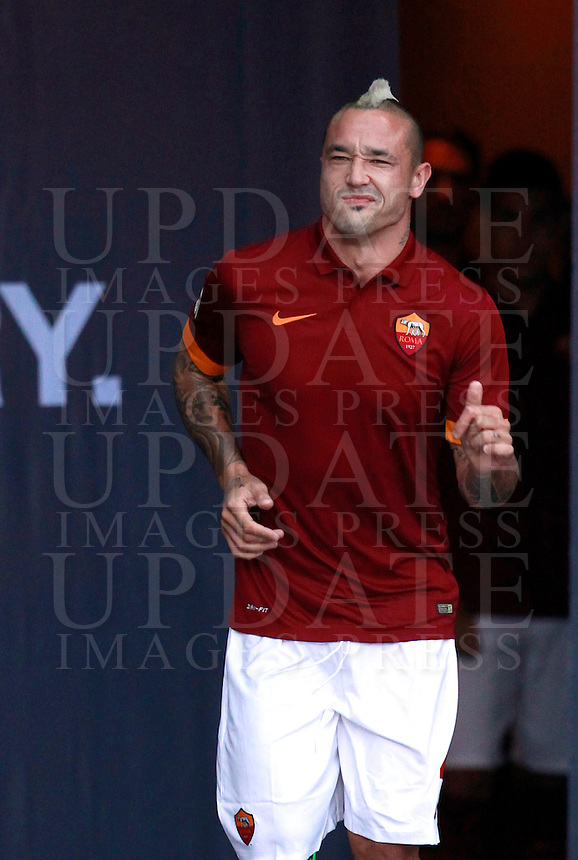 Calcio, amichevole Roma vs Fenerbahce. Roma, stadio Olimpico, 19 agosto 2014.<br /> Roma midfielder Radja Nainggolan, of Belgium, arrives for the team's presentation, prior to the friendly match between AS Roma and Fenerbahce at Rome's Olympic stadium, 19 August 2014.<br /> UPDATE IMAGES PRESS/Isabella Bonotto