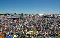 A sea of people and umbrellas watch the festivities of the Dayton Airshow