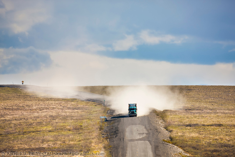 Semi tractor hauls supplies along the remote James Dalton Highway, which terminates at the oil fields of Prudhoe Bay in Alaska's arctic.