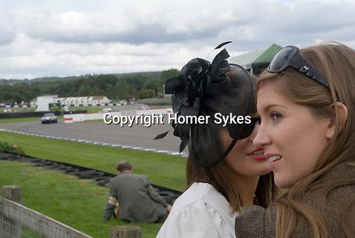 Goodwood Festival of Speed. Goodwood Sussex. UK Girls whispering.
