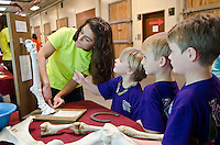 Jade Guilbeau, class of 2015 DVM student, explains how the bones of a horses leg are very similar to the bones in the human arm to Mooreville Elementary students, Sutton Scruggs (6), Cayden Kingsley (6), Conner Enlow (7) during the Mississippi State University College of Veterinary Medicine Open House on April 5. Jade is the daughter of Mary Matthes Guilbeau, MSU-CVM class of 1986 graduate. (Photo by MSU College of Veterinary Medicine/Tom Thompson)
