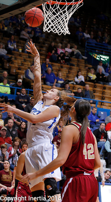 SIOUX FALLS, SD - MARCH 9:  Rebecca Bruner #34 of IPFW gets a layup past Denver defender Alisan Janacek #42 during their quarterfinal game at the 2014 Summit League Basketball Championships Sunday at the Sioux Falls Arena.  (Photo by Dick CarlsonInertia)
