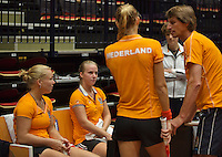 The Netherlands, Den Bosch, 16.04.2014. Fed Cup Netherlands-Japan, training, Kiki Bertens (L) Richel Hogenkamp (NED) and Arantxa Rus  listen to captain Paul Haarhuis<br /> Photo:Tennisimages/Henk Koster