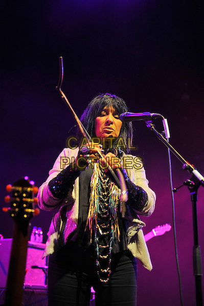 Buffy Sainte-Marie .Performing at the Meltdown Festival, Queen Elizabeth Hall, Waterloo, London, England. .7th August 2012.on stage in concert live gig performance music half length silver sequins sequined jacket fingerless gloves black scarf  mouthbow, .CAP/MAR.© Martin Harris/Capital Pictures.