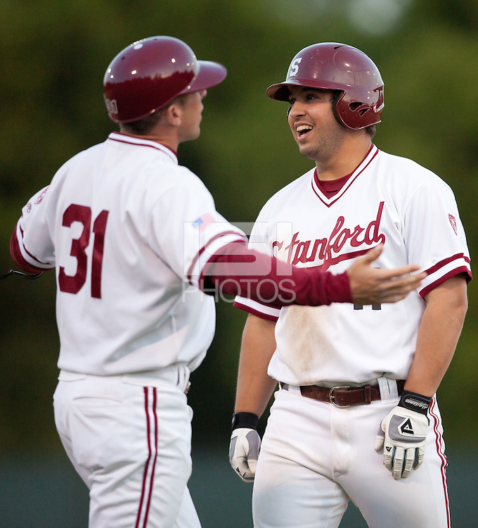 STANFORD, CA - April 12, 2011: Assistant Brock Ungricht of Stanford baseball argues a close call at first while Dave Giuliani laughs in disbelief during Stanford's game against Pacific at Sunken Diamond. Stanford won 3-1.